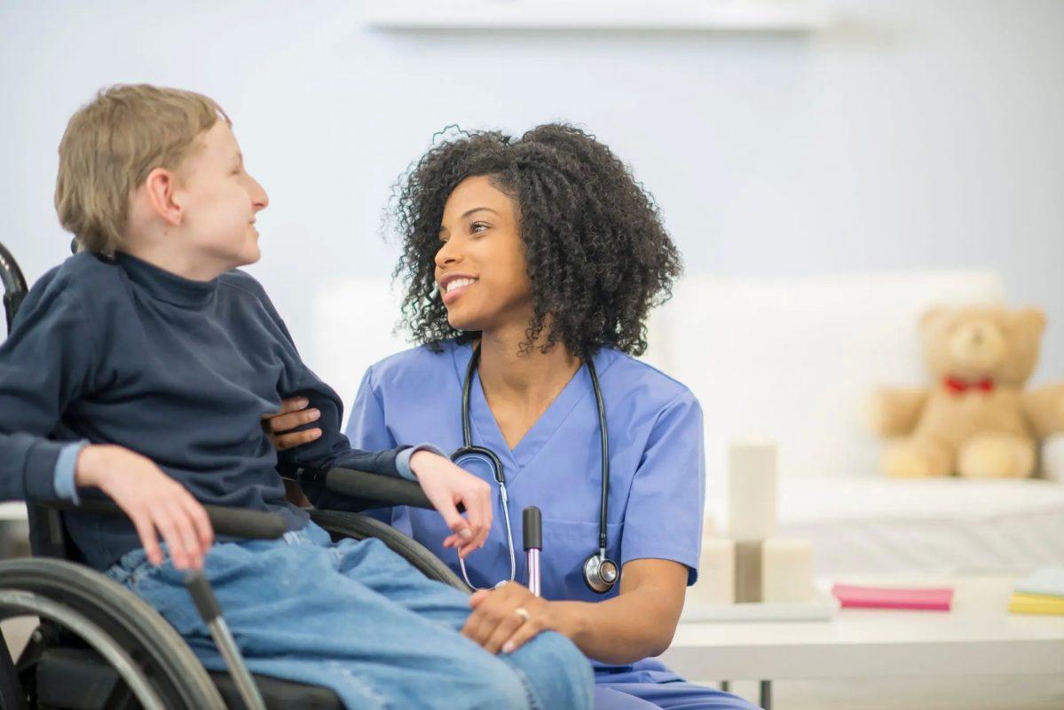 A nurse accompanying a disabled individual